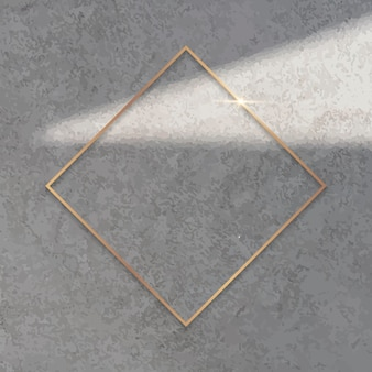 Romb złota rama na tle cementu wektor