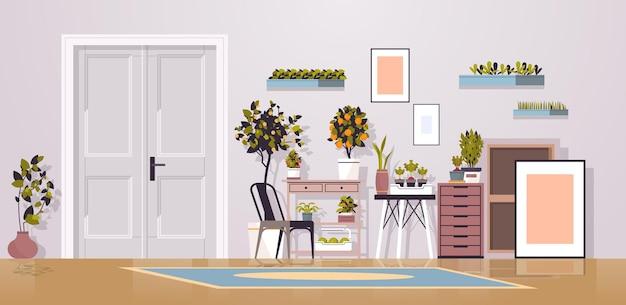 Rośliny doniczkowe w szklarni na półkach koncepcja ogrodnictwa