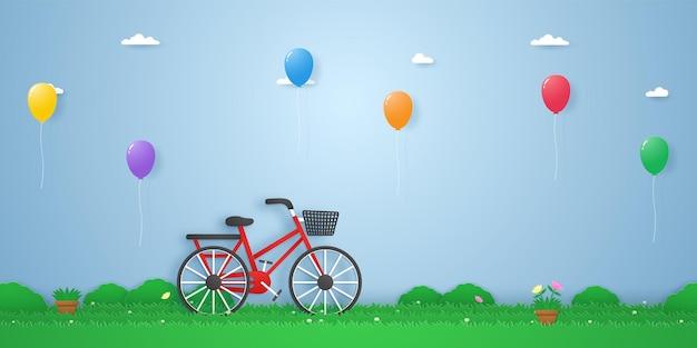 Rower w ogrodzie z kolorowymi balonami unoszącymi się w papierowym stylu