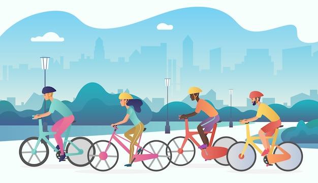 Rowerzyści ludzie jeżdżący na rowerach w publicznym parku miejskim