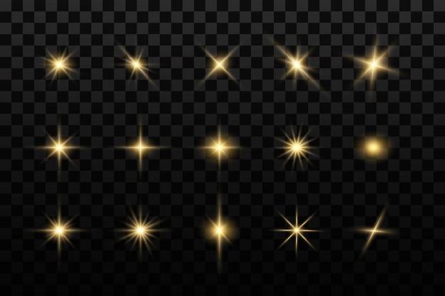 Rozbłysk słońca. świecące gwiazdy. błyszczące złote gwiazdy na białym tle.