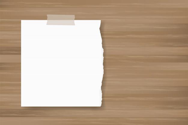 Rozdzierający papierowy tło kij na drewnianej teksturze.