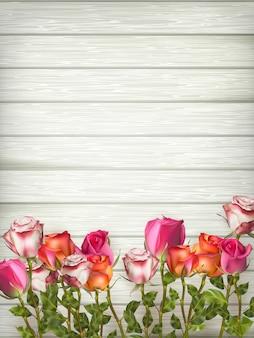 Róże na drewnianym stole tło. plik w zestawie