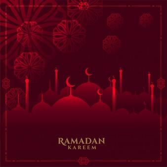 Rozjarzony czerwony ramadan kareem tło z meczetem