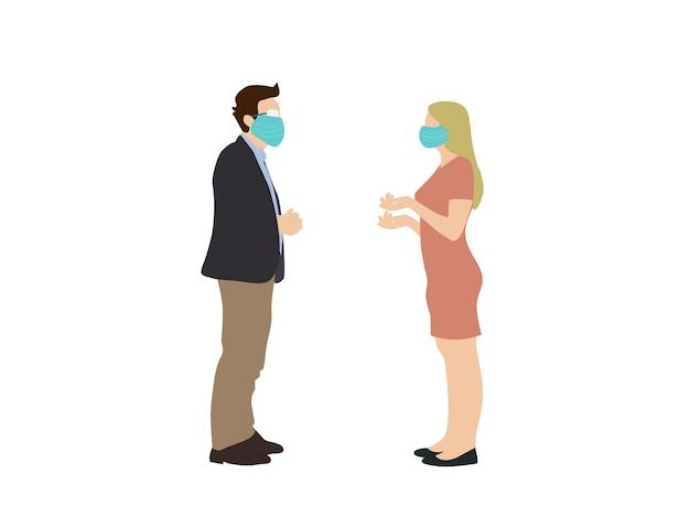 Rozmawiają kobiety i mężczyźni noszący maski, aby zapobiec wirusowi.