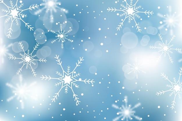 Rozmyte płatki śniegu w zimowej tapecie