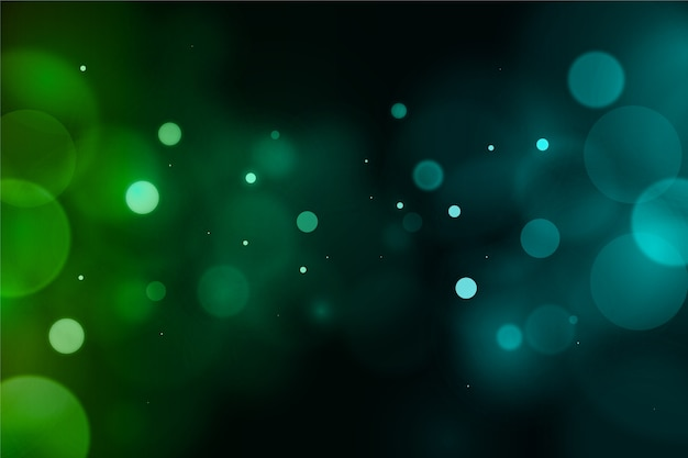 Rozmyty zielony bokeh świecenia tło