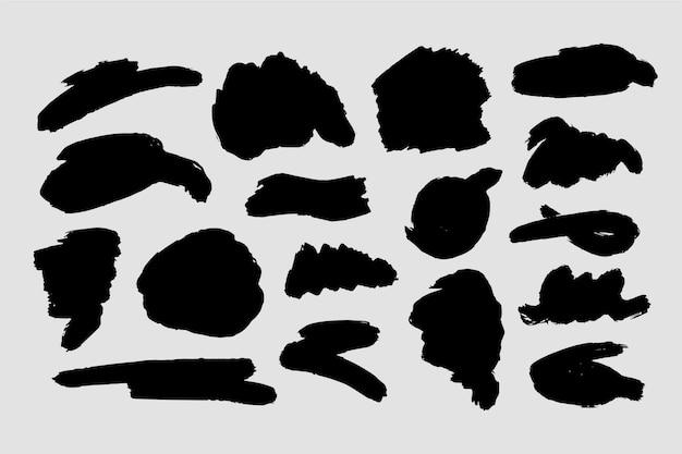 Różne abstrakcyjne kształty pociągnięć pędzlem tuszu
