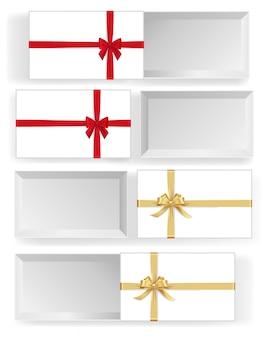 Różne białe pudełka z czerwonymi i złotymi kokardkami