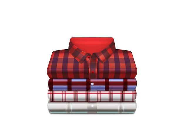 Różne kolorowe bawełniane koszule w kratkę złożone w stos