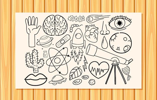 Różne pociągnięcia doodle dotyczące sprzętu naukowego na papierze