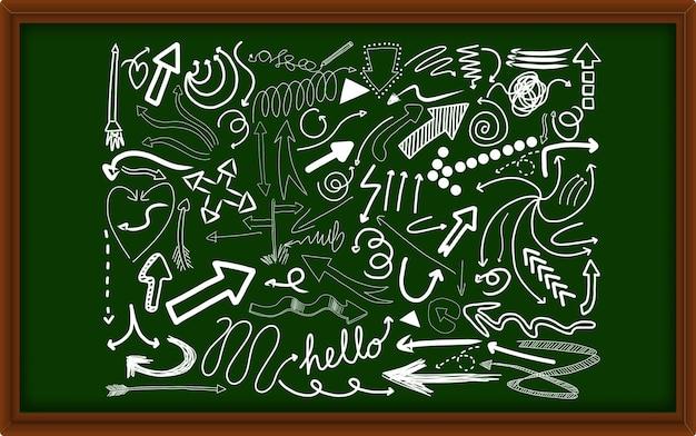Różne pociągnięcia doodle na tablicy kredowej