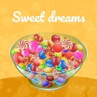 Różne rodzaje cukierków w przezroczystej płytce na żółtym tle