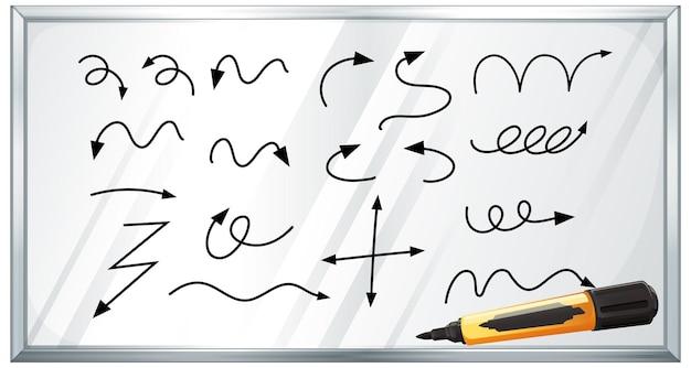 Różne rodzaje ręcznie rysowane zakrzywione strzałki na białej tablicy