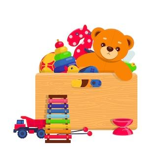Różne zabawki dla dzieci w drewnianym pudełku na białym tle. ilustracja