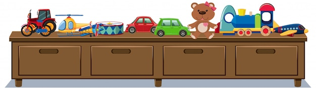 Różne zabawki na drewnianych szufladach