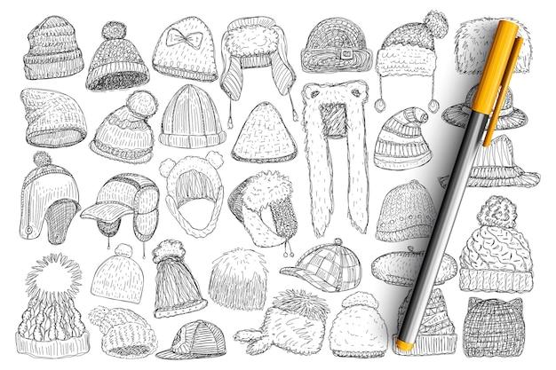 Różne zimowe czapki i czapki doodle zestaw. kolekcja ręcznie rysowane stylowe czapki z futrem do noszenia na zewnątrz w okresie zimowym na białym tle.