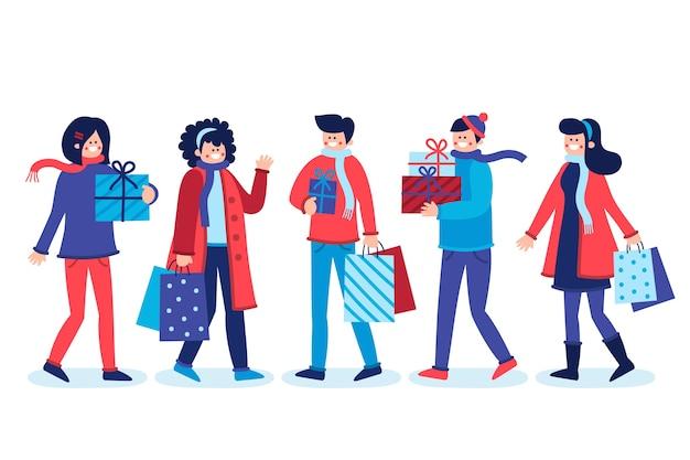 Różni ludzie kupują prezenty na boże narodzenie