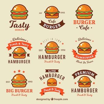 Różnorodność płaskich logo z kolorowymi hamburgerami