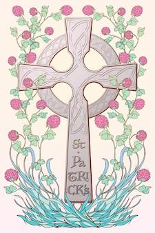 Różowa koniczyna w rozkwicie i tradycyjny krzyż celtycki. świąteczny projekt dnia świętego patryka.