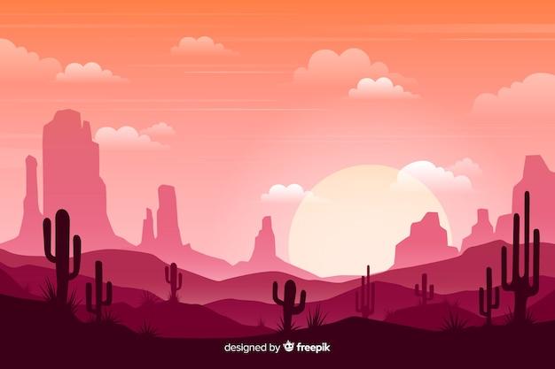Różowa pustynia z jaskrawym słońcem i chmurnym niebem