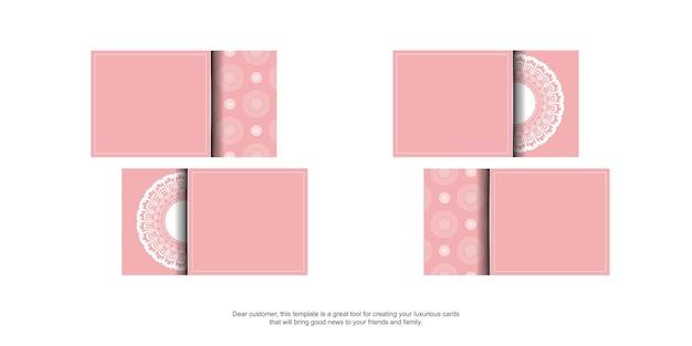 Różowa wizytówka z białym ornamentem mandali dla twojej firmy.