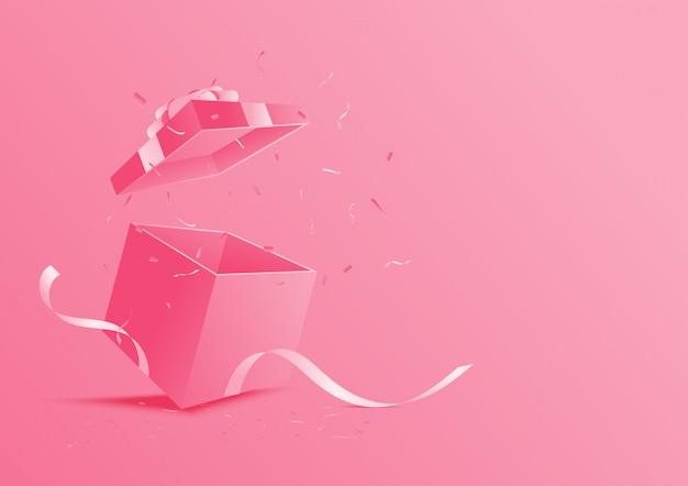 Różowe otwarte pudełko upominkowe.