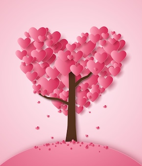 Różowe serce spadające z drzewa w stylu sztuki papieru
