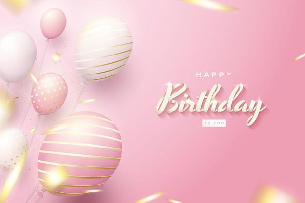Różowe tło urodziny z wzorzystymi balonami