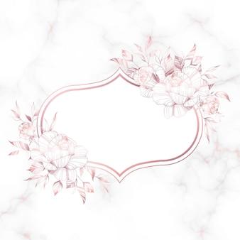 Różowe złoto rama z kwiatem róży na tle marmuru.