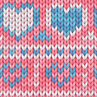 Różowy i niebieski wzór dzianiny bez szwu z sercami. wełniana tkanina.