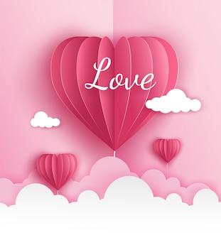 Różowy papier origami balonu na ogrzane powietrze w kształcie serca latające po niebie nad chmurą w walentynki z etykietą miłość. projekt ilustracji wektorowych sztuki w stylu cięcia papieru.