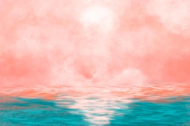 Różowy pochmurny zachód słońca w tle