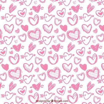 Różowy wzór z ręcznie rysowane serca na walentynki
