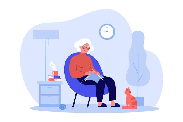 Rudowłosy kot obserwujący jak babcia robi na drutach. ilustracja wektorowa płaski. starsza kobieta odpoczywa w fotelu i dziania ubrania z przędzy w domu. komfort, zwierzę domowe, dzianie, hobby, koncepcja starości