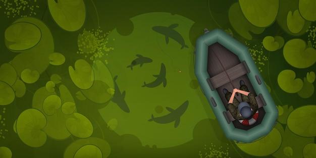 Rybak w gumowej łódce łowi ryby