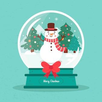 Rysowana świąteczna kula śnieżna z uśmiechniętym bałwanem