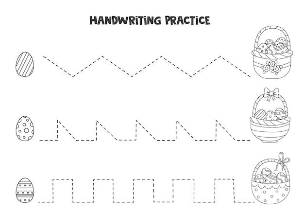 Rysowanie linii dla dzieci z uroczymi czarno-białymi koszykami wielkanocnymi. ćwiczenia pisma ręcznego dla dzieci.