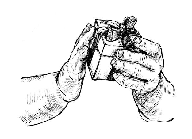 Rysunek ręki trzymającego pudełko