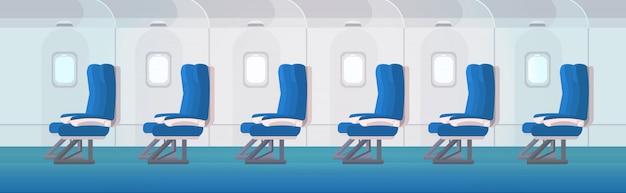 Rząd miejsc pasażerskich samolotu z iluminatorami puste wnętrze samolotu bez ludzi