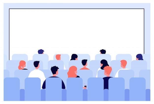 Rzędy ludzi siedzących na siedzeniach w sali kinowej