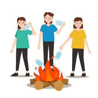 Rzucanie masek medycznych w koncepcji pożaru