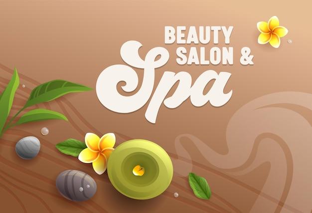 Salon piękności spa atrybuty jako świeca zapachowa, kamienie do masażu, liście eukaliptusa i kwiaty frangipani plumeria na tle powierzchni drewnianego stołu