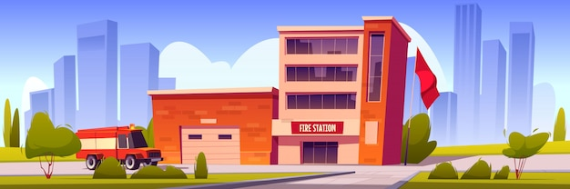 Samochód strażacki jadący do budynku stacji z garażem