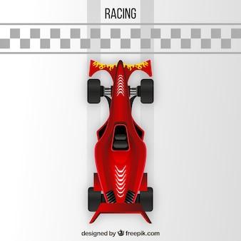 Samochód wyścigowy formuły 1 przekraczający linię mety od góry