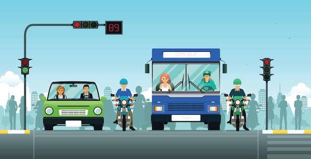 Samochody i motocykle czekają na sygnalizację świetlną.
