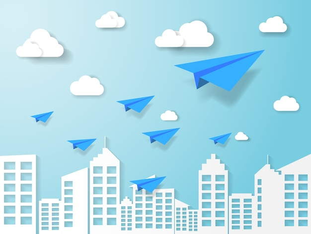 Samolot leci na błękitne niebo z chmury i budynku w tle