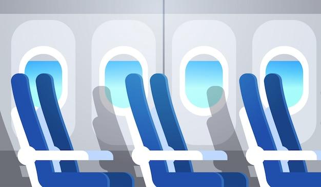 Samolot pasażerski rząd miejsc z iluminatorami pusty brak ludzi samolot pokładzie wnętrze płaskie poziome