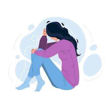 Samotność nieszczęśliwa kobieta siedzi na podłodze
