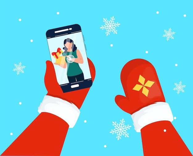 Santa claus ręce przy użyciu smartfona. ilustracja wektorowa święty mikołaj daje prezenty w internecie. prezenty online z okazji świąt. obecne wakacje internetowe. zimowe zakupy online. koncepcja blokady.